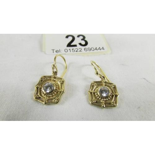 23 - A pair of 9ct gold earrings, 3 grams....
