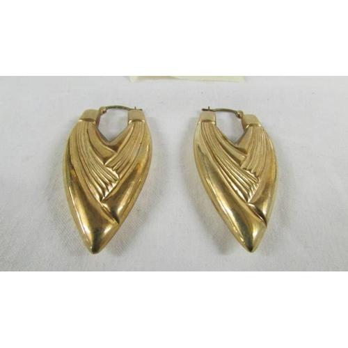 24 - A pair of 9ct gold earrings, 6 grams....