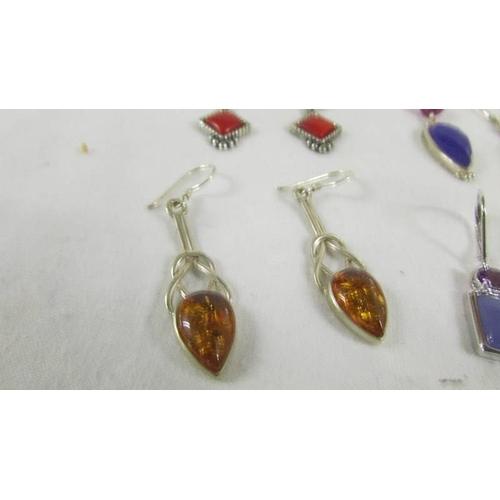 28 - 4 pairs of silver earrings....