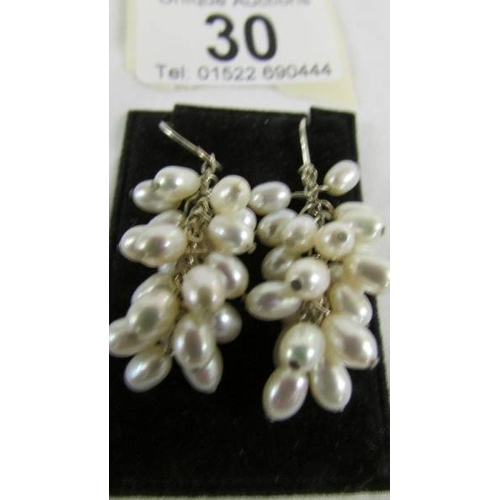 30 - A pair of pearl pendant earrings fashioned as bunches of grapes....