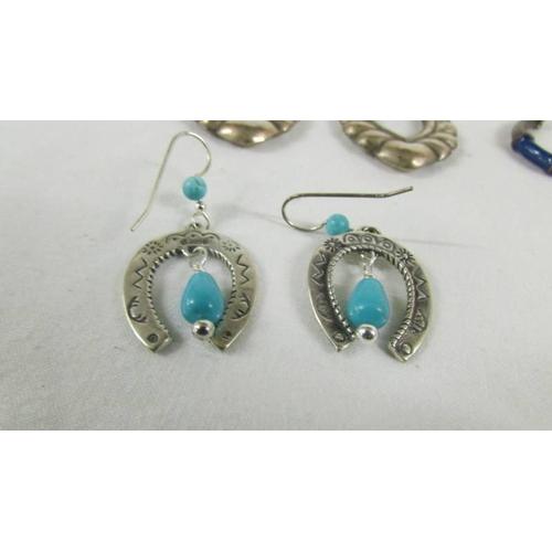 31 - 4 pairs of silver earrings....