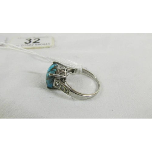 32 - A silver ring set turquoise stone,size U....
