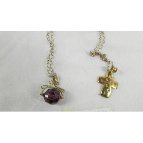 35 - A 9ct gold fob and a 9ct gold cross on a 9ct gold chain,  5.5 grams without fob....