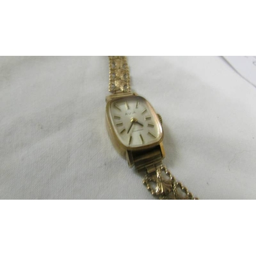 36 - A 9ct gold ladies Avia wrist watch on 9ct gold bracelet, total weight 13.6 grams....