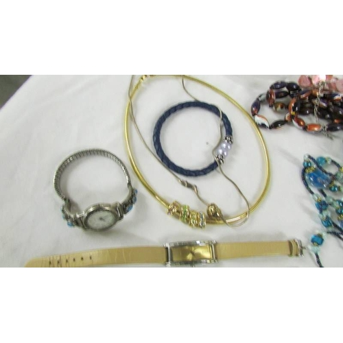 37 - A good lot of necklaces, bracelets and wristwatches....
