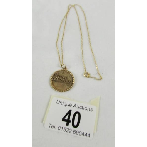 40 - A 10k gold 'Mother' pendant on a 9ct gold chain. 5.7 grams....