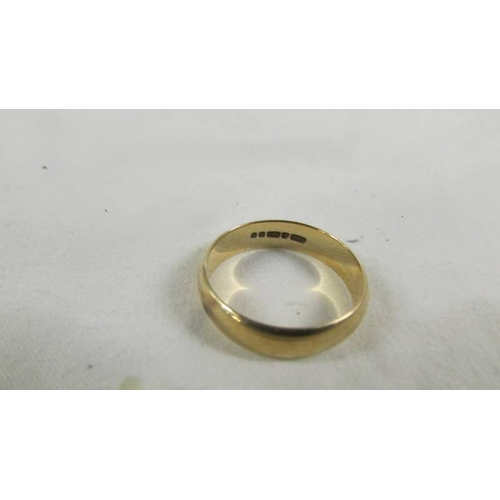 42 - A 9ct gold wedding ring, size W, 4.5 grams....
