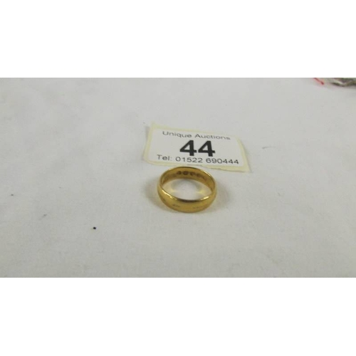 44 - A 22 ct gold wedding ring, size M, 5.2 grams....