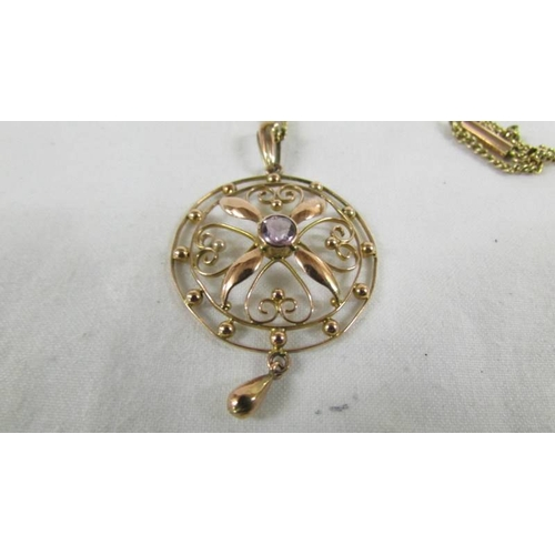 48 - An unmarked yellow metal Edwardian pendant on chains, 9.5 grams....