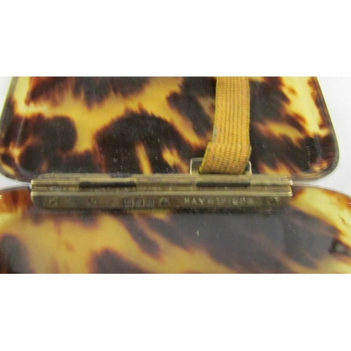 49 - A Tortoise shell cigarette case with gold monogram and silver hinge, dated May 6th 1925....