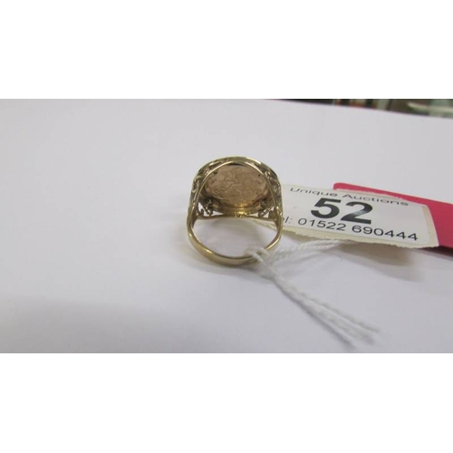 52 - A gold ring with an emblem of George and the dragon, hall marked for Birmingham, total weight 3.2 gr...