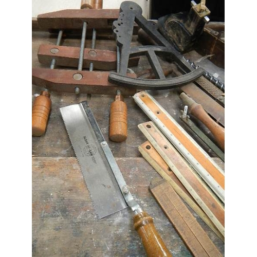 307 - An interesting lot of joinery items including wooden clamps, oil stones, rules etc.,