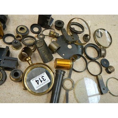 314 - A good lot of vintage optical lenses.
