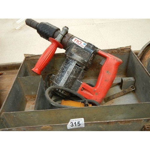 315 - A Hilti TE17 and a Black and Decker 9'' grinder, both 110V and a box of masonry drill bits.