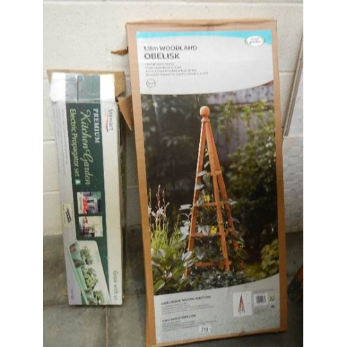 319 - A new boxed woodland obelisk and a boxed electric propagator.