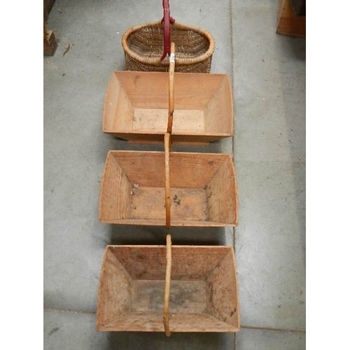 320 - 3 graduated matching pine garden trugs and a small wicker basket.