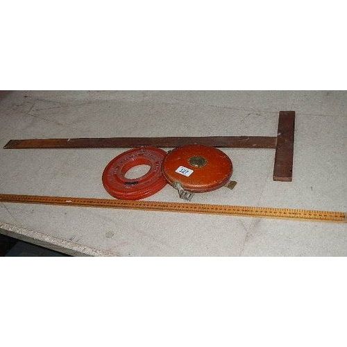 327 - A vintage Rabone Chesterman leather tape, a tailor's yard stick, an Engineer's 30 mtr tape and a dra...