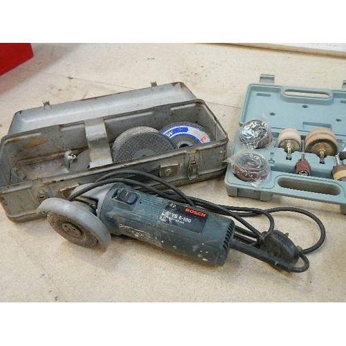 329 - A Bosch impact drill and a 4'' grinder, both working.