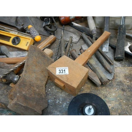 331 - A mixed lot of tools including hammers, saws, 2 electric drills, grind stones and a good selection o...