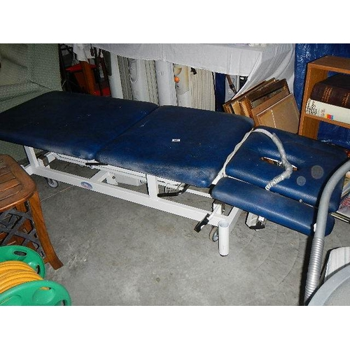 349 - An electric massage table.