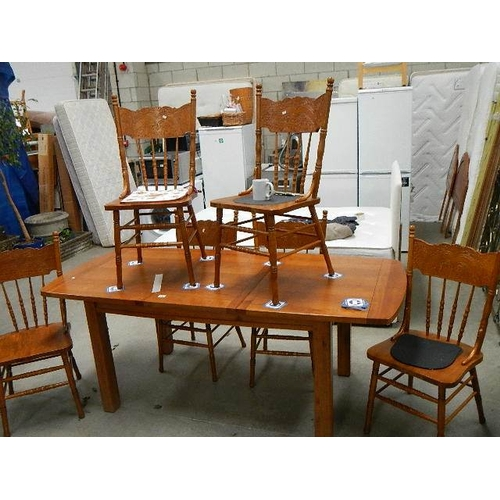 352 - A good quality solid oak extending dining table with 6 chairs,.