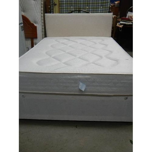 353 - A good clean double divan with mattress and headboard.