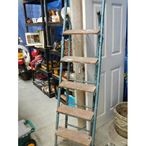 354 - A folding work bench and a 5 tread step ladder.