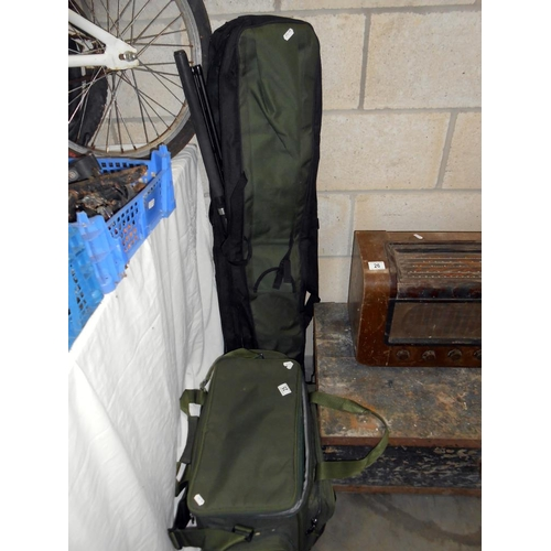 25 - 2 bags of fishing tackle including reels, floats etc.