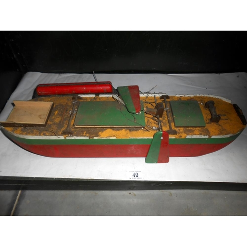 49 - A vintage wooden model of a boat a/f length 59cm