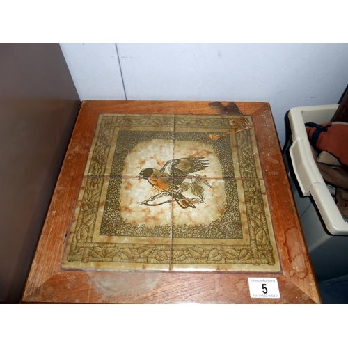 5 - A small coffee table with tiled top depicting a bird (in need of a clean)