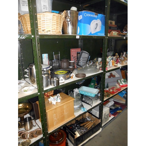 54 - 4 shelves of kitchen ware including Pyrex, cutlery, cow creamer etc,