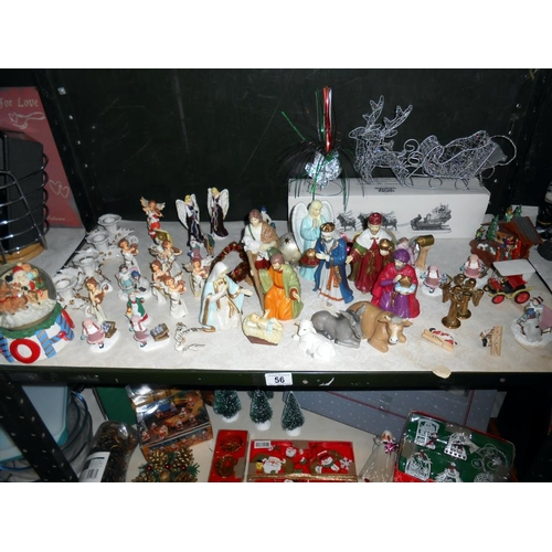 56 - 3 shelves of Christmas decorations including nativity figures and vintage items