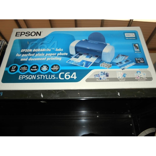 58 - A boxed Epsom photo R340 and Stylus CO4 printers, shredder and a digital photo scanner, all, unteste...
