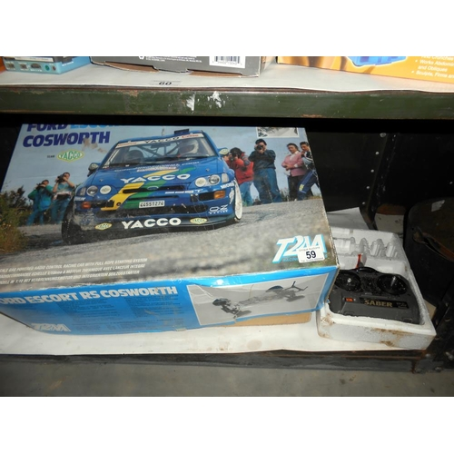 59 - A boxed T2M Ford Escort RS Cosworth remote control car 1/10 scale, condition and completion unknown