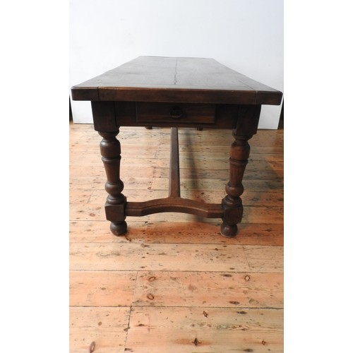 3 - A 19TH CENTURY FRENCH OAK FARMHOUSE TABLE ON TURNED LEGS, on shaped stretcher bar support with singl...