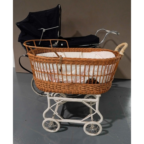 6 - A WILSON 'COACH BUILT' PRAM WITH DARK BLUE LIVERY, curved coach springs and pull-over fabric hood an...