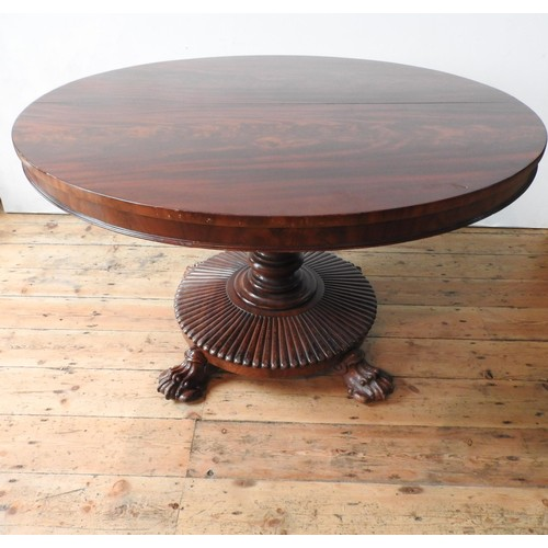10 - A VICTORIAN MAHOGANY CIRCULAR TILT-TOP BREAKFAST TABLE, with turned central pillar on 'sunburst' bas...