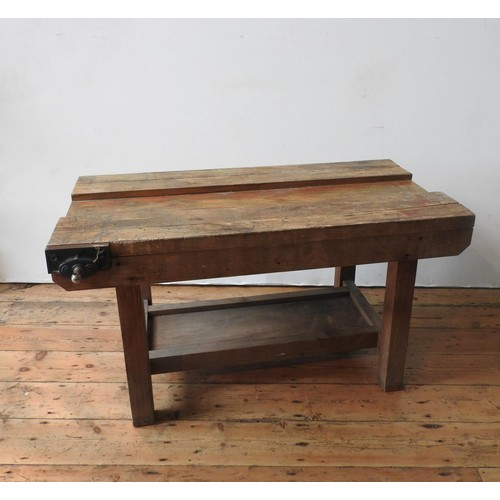 14 - A VINTAGE WORKSHOP BENCH, on a pine base with shelf below and bench vice attached, 66 x 122 x 62cm