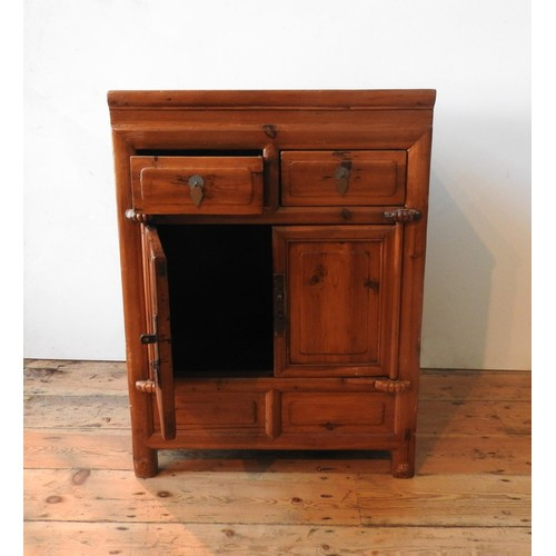 21 - AN ORIENTAL STYLE HARDWOOD TWO DOOR CUPBOARD, with two drawers, 86 x 64 x 50cm
