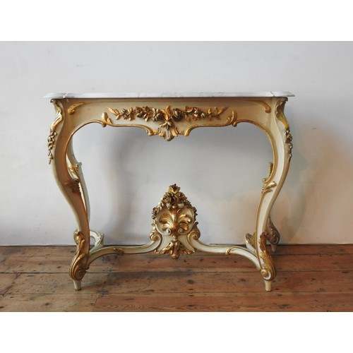22 - A 19TH CENTURY MARBLE TOP ROCOCO STYLE CONSOLE TABLE, the bevelled marble top sitting on a cream pai...
