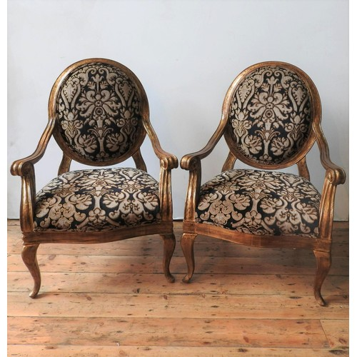 23 - A PAIR OF DURESTA HAND MADE LOUIS XV STYLE GILDED ARMCHAIRS, the gilded scroll arm frames upholstere...