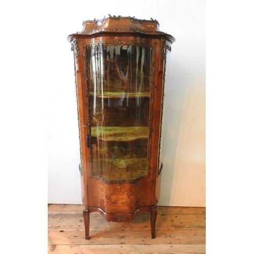 26 - A 20TH CENTURY LOUIS XV STYLE WALNUT VENEER MARQUETRY INLAID VETRINE CABINET, with glazed serpentine...