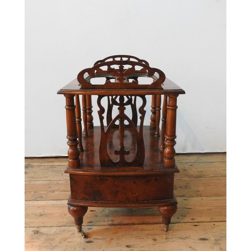 31 - A BRIGHTS OF NETTLEBED BURR WALNUT CANTERBURY, with a single drawer, spindle supports and ornate fre...