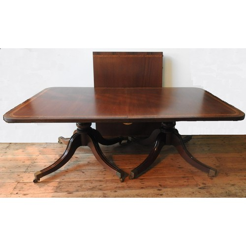 36 - A 20TH CENTURY TWIN PEDEDSTAL D-END CROSS BANDED DINING TABLE AND 6 DINING CHAIRS, with tilting end ...