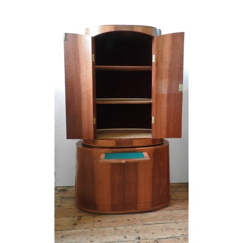 39 - A CONTEMPORARY TWO SECTION COCKTAIL CABINET, ovoid form with fitted drawers to base and shelves to t...