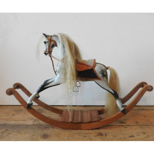 42 - A STEVENSON BROS. MINIATURE MODEL ROCKING HORSE, in dappled grey and black colours with brass Stephe...