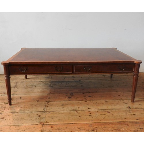 43 - A 20TH CENTURY MAHOGANY CROSS BANDED COFFEE TABLE WITH FOUR DRAWERS, on fluted tapered legs, 46 x 13...