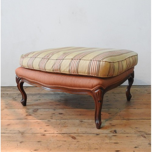 45 - A WADE UPHOLSTERY 'RIMINI' ARMCHAIR AND FOOTSTOOL, both upholstered in gold and burgundy pinstripe p...