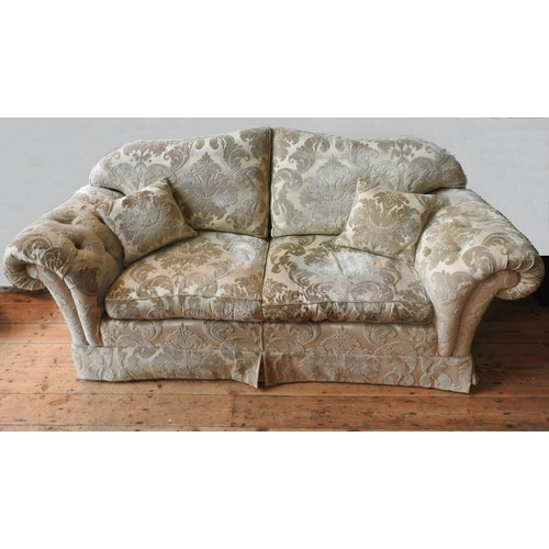 46 - A LARGE BROCADE UPHOLSTERED THREE SEAT SOFA AND MATCHING SOFA,with scroll arms, foliate brocade patt...