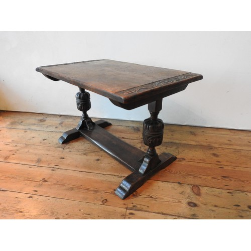 47 - A CARVED STRETCHER BAR COFFEE TABLE